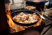 Sea food preparing on the fire — Stock Photo
