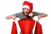 Jovem mulher com sacos de compras no Natal — Fotografia Stock