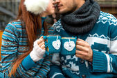 Couple with coffee cups in winter — Stock Photo