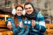 Young couple with coffee in winter outside — Stock Photo