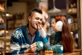 Young couple with coffee at the cafe in winter — Stock Photo