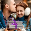 Young couple with gift boxes at the cafe in winter — Stock Photo #59283103