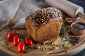 Borodino bread on wooden board — Stock Photo
