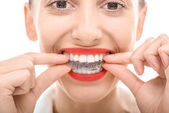 Wearing orthodontic silicone trainer — Stock Photo