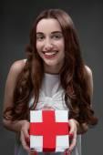 Woman with red cross — Zdjęcie stockowe