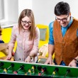 Friends playing table football — Stock Photo #63395981