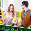Friends playing table football — Stock Photo #63396393