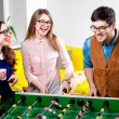 Friends playing table football — Stock Photo #63397529