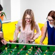 Friends playing table football — Stock Photo #63398079