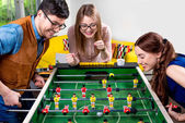 Friends playing table football — Stock Photo