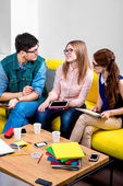 Students working on the couch — Stock Photo