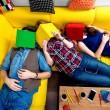 Sleeping and tired students on the couch — Stock Photo #63413595