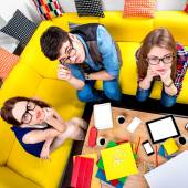 Three nerds on the couch — Stock Photo