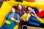 Sleeping and tired students on the couch — Stock Photo