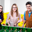 Friends playing table football — Stock Photo #63423727