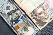 Ukrainian and American money — Stock Photo