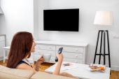 Woman watching TV — Stock Photo