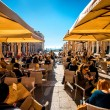 Republic square in Split with restaurants full of people. — Stock Photo #66075999