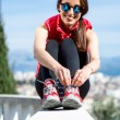 Sporty woman on the park alley with city view — Stock Photo #66848877