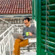 Man with laptop on the balcony — Stock Photo #66851567