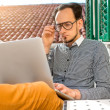 Man with laptop on the balcony — Stock Photo #66851601