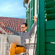 Man with laptop on the balcony — Stock Photo #66851623