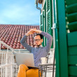 Man with laptop on the balcony — Stock Photo #66851675