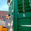 Man with laptop on the balcony — Stock Photo #66851695