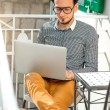 Man with laptop on the balcony — Stock Photo #66852215