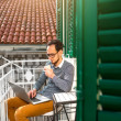 Man with laptop on the balcony — Stock Photo #66852433