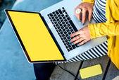 Typing on laptop keyboard — Stock Photo