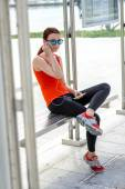 Sport woman at the bus station — Stock Photo