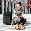 Woman with travel bag in the old city — Stok fotoğraf #67930855