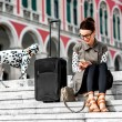 Woman with travel bag in the old city — Stockfoto #67930987