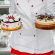 Chef holding cakes — Stock Photo #67933247
