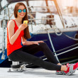 Woman sitting near the yachts — Stock Photo #68366781