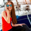 Woman sitting near the yachts — Stock Photo #68367047