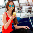 Woman sitting near the yachts — Stock Photo #68367107