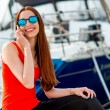 Woman sitting near the yachts — Stock Photo #68367271