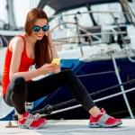 Woman sitting near the yachts — Stock Photo #68367639