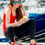 Woman sitting near the yachts — Stock Photo #68368291