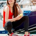 Woman sitting near the yachts — Stock Photo #68369077