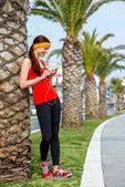 Runner near the palm tree — Stok fotoğraf