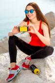 Sport woman on the rocky beach — Stock Photo