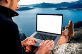 Man with laptop on the top of mountain — Stock Photo
