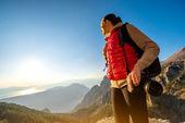 Young traveler photographer on the mountain — Stock Photo