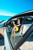 Woman making self portrait in the car — Stock Photo