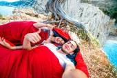 Young couple in sleeping bags near the sea — Stock Photo