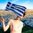 Woman with Greek flag on Athens cityscape background — Stock Photo #72980493