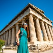 Woman with photo camera near Hephaistos temple in Agora — Stock Photo #72993383